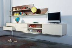build storage entertainment/bar/mirrors behind/black/stainless/lighting modern