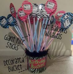 I am so going to do this next year!  I always buy those giant pixie stix at SAMS club!  My girls love them!