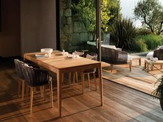 The Mood dining table by Tribu is so much more than an ordinary wooden outdoor table. Its tapered legs and beautifully finished round edges give the table a friendly and soft look. #Tribu #outdoorliving #outdoordecor #outdoorfurniture #dawsonandco