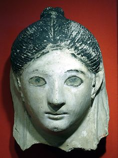 Mask of a woman with her hair in a small knot Period: Roman Period Date: A.D. 150 perhaps Geography: Country of Origin Egypt