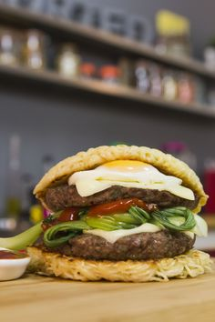 Ramen burger | Sorted Food - Double burger in a ramen noodle bun. Complete with Bok Choy, Fried egg and spicy ketchup! Full recipe at http://sortedfood.com/#!/fridgecam/ramenburger/