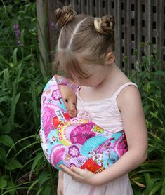 Let your little girl imitate mom with her dolls by carrying them in her very own doll sling. Via Etsy.com
