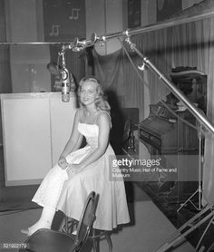 June Webb, RCA Studio B, Nashville, late 1950s or early 1960s. Note that she has a cast on her right leg; crutches visible in lower right corner of photo.