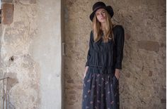 Trifoglio hat, black. Melania shirt, black. Evita skirt, washed black.