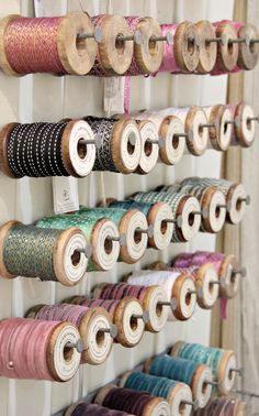 Ribbon storage on wooden spools. Coin Couture, Ribbon Holders, Thread Holder, Craft Room Storage, Craft Organization, Craft Rooms, Ribbon Organization, Space Crafts, Home Crafts