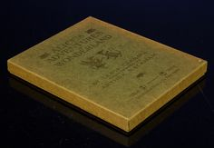 Something really rare:  original 1907 gift box which contains a virtually mint example of the First Deluxe American Edition of Arthur Rackham's ALICE IN WONDERLAND.