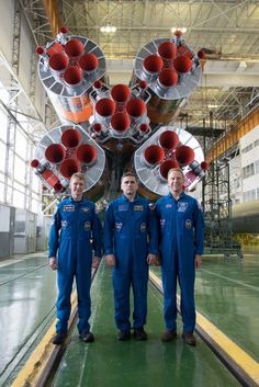 From left: ESA astronaut Tim Peake, commander-cosmonaut Yuri Malenchenko and NASA astronaut Tim Kopra. The trio will leave our planet on 15 December 2015 from Baikonur cosmodrome in Kazakhstan on the Soyuz rocket seen behind them.  Delivering 26 million horse-power, their Soyuz rocket will carry them 1640 km downrange and lift them 210 km above our planet in 10 minutes.