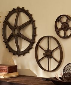 Rustic Wall Art: Gears in coordinating shapes are modeled after rustic tractor parts discovered in a country store. They take on a unique, sculptural beauty as wall display.