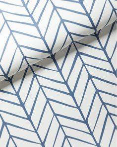 Taking its cue from traditional herringbone and chevron patterns, our original design is both graphic and organic on pure white. We love how the lines are perfectly imperfect, an effect that could only be brought to life to such exacting detail by one of the country's most historic wallcovering manufacturers.