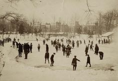 Men and boys ice skating on a frozen pond. (1900)
