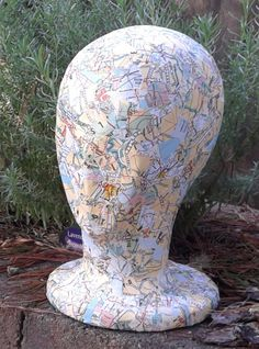 Decoupaged styrofoam head with old maps Styrofoam Head, Head Planters, Mannequin Heads, Hat Stands, Charity Shop, Old Maps, Gypsum, Vintage Maps, Decoupage