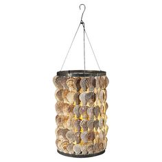 Hang this striking candle lantern above your buffet or patio table to cast a flickering glow over after-dinner drinks or potluck suppers. Hanging Candles, Candle Lanterns, Coastal Art, Patio Table, Light Art, Joss And Main, Shells, Candle Holders, Glow