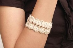 I need something like this for my ankle to cover my tattoo. beige crochet bracelet