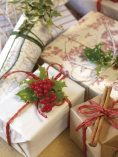 pretty packages with holly and cinnamon sticks