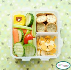 mixed veggies with an adorable little bear container filled with dip. She also had a container of crackers and a container of bear-shaped cheese with a food marker face, and some cheese scraps underneath.