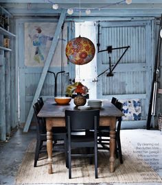 I've always been really fond of rustic, vintage spaces... furniture that looks worn-out and old intrigues me.  It gives most spaces a really cozy feeling.  Love these doors and the light!