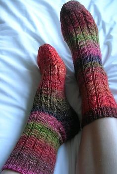 Ribbed sock with cables!...Ravelry: So Simple Silk Garden pattern by Glenna C. (and thank you for the free pattern)!