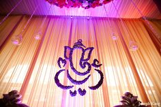 What about putting the logo on drapes like this. I think it is more elegant than the projector