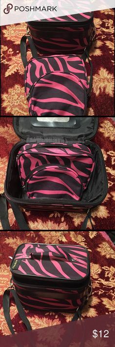 3 JGarden cosmetic cases 3 Black and hot pink zebra striped cosmetic cases. 1 large travel case with adjustable shoulder strap and 2 smaller zippered cases. Used but in immaculate condition. Largest case has a mirror. No damage. JGARDEN  Bags Cosmetic Bags & Cases
