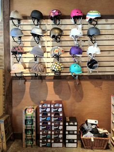Our helmet display wall (looking a little low on inventory) with pseudo slat-wall made from re-worked pallet wood.