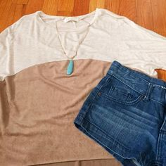 NWOT Color-Block Tee Great top with suede color block. Purchase from a local boutique. Soo smooth and cozy.   🌀Condition: NWOT ❌no trades ✅in app transactions only  ✅make an offer ✅bundle and save Millibon u.s.a Tops Tees - Short Sleeve