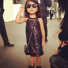 Alexander Wang's niece carrying her first Chanel bag and a one of a kind (Alexander Wang) python shift. I guess it's never too early to start?