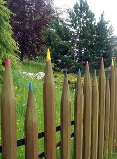 I can picture the stockade fence at my parents' house...a whole range of colored pencils! Cool Fences for Your Yard and Garden