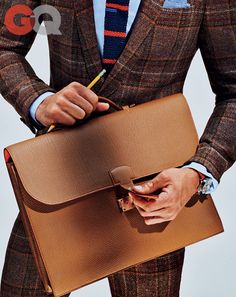 Mark Anthony GreenBriefcase, $8,750, by Hermès Suit, $2,163, by Etro Watch by Shinola.