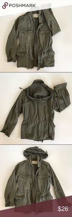 American Eagle Rugged Cargo Jacket Excellent condition. This a rugged heavier style Cargo jacket. Features four front snap closure pockets. Drawstring waist. Inside pocket with Velcro closure. Snap & Zip front closure. Has a hood which can be tucked away into the collar. Size small. American Eagle Outfitters Jackets & Coats Utility Jackets