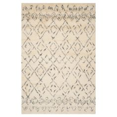 Stylishly anchor your living room seating group or entryway with this hand-woven rug, showcasing a diamond motif in white and grey.