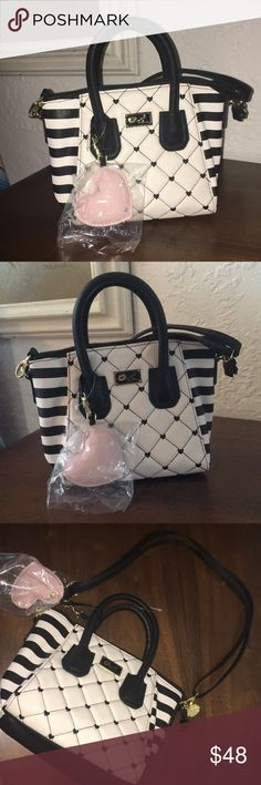NWOT Betsey Johnson Satchel Super cute and in perfect condition Betsey Johnson Bags Satchels