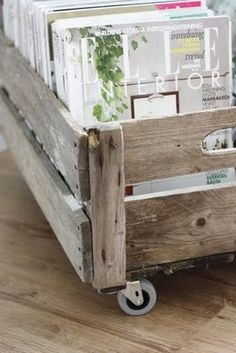 I've been trying to find a way to store my magazines.  This DIY might work - I could roll it under the guest bed. Old box and Ikea wheels. Fantastic IDEA