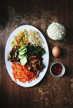 """""""Making Bibimbap (비빔밥) - Korean Mixed Rice"""" - I've done this before and it is great. Still looking for the right fern though..."""