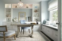 Light, energetic and wonderful way to start a work day. We love the white built-in cabinetry and window seat accented with soft blue. The design is calm and clean but made to be a hardworking space.