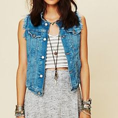 Free People Cut Off Denim Vest Lovely shade of blue in a soft denim vest with cut off, frayed arms.  Excellent condition - only worn a handful of times.  From a pet & smoke free home. Free People Tops