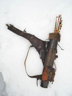 Multifunctional Tooled Leather Quiver Holding a Bow, an Axe, a Knife and a Rope with a Detachable Pouch