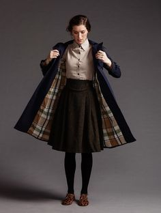 brown wool yoked skirt, blush top, navy coat with brown plaid lining, skin shoes