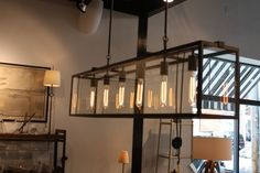 Large chandelier over dining table with led edison bulbs