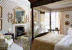 Anne Rosse decorated the Conroy Room in the 1930s, using French wallpaper and grosgrain curtains with stenciled borders - mantel is 19th century
