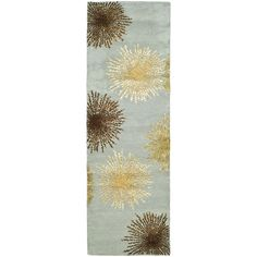 <li>Add functional beauty to your home decor with a wool rug </li> <li>Contemporary floor rug adds warmth and texture to any room</li> <li>Area rug offers rich shades of gold, beige, blue and chocolate </li>