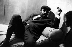 Thelonious Monk relaxes with his wife, Nellie, before performing at the Royal Festival Hall in London on April 29, 1961