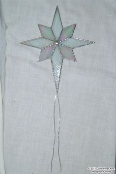Searching for a tree topper. Christmas Things, Christmas Star, White Christmas, Stained Glass Studio, Tree Toppers, Searching, Christmas Decorations, Holidays, Unique Jewelry
