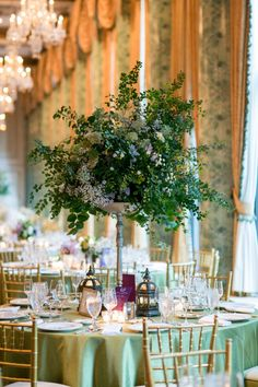 Extremely elegant centerpieces: http://www.stylemepretty.com/illinois-weddings/chicago/2015/02/06/sophisticated-chicago-wedding-at-the-drake-hotel/ | Photography: MaiCamera - http://www.maicamera.com/