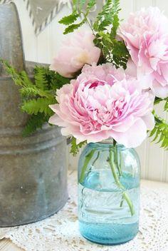 Pink peony in a vintage blue mason jar