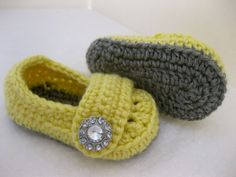 Grey and yellow baby booties.
