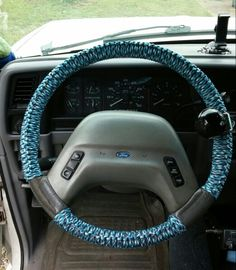 Steering wheel cover. I used 550 paracord. I bought 100 ft of cord but didnt use all of it on the wheel. The knot I used is called a half hitch.