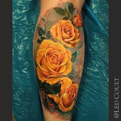 The most beautiful realistic yellow roses I have ever seen tattooed!! By the great Led Coult