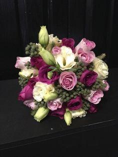 Roses, lisuanthus, berries bridal bouquet.jpg