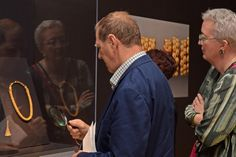 Onlookers dazzled by ancient Philippine gold artifacts, Asia Society Museum, New York.