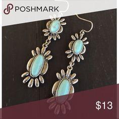 Long Silver & Turquoise Earrings Brand new long silver & turquoise earrings. Tags: country girl cowgirl jewelry boots western jewelry earrings Boho gypsy tribal Aztec Navajo southern southwest western rodeo cowgirl style Jewelry Earrings